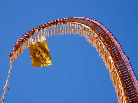 balinese omkara symbol at the top of penjor