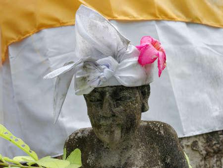 balinese: balinese statue wearing traditional headband