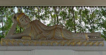 reclining: reclining buddha statue, in mendut buddhist monastery Stock Photo
