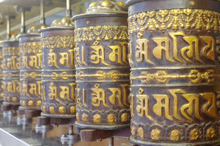 devote: prayer wheels in thekchen choling temple, singapore