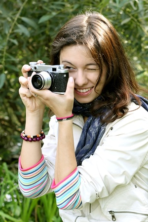 Beautiful girl with an old camera on nature background Stock Photo - 10488416