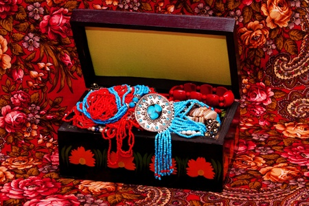 Wooden treasure chest on red headscarf photo