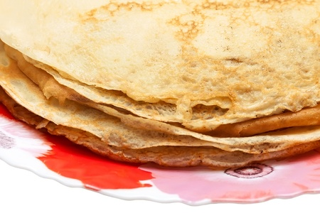 rubicund: Pancakes on plate isolated over white background
