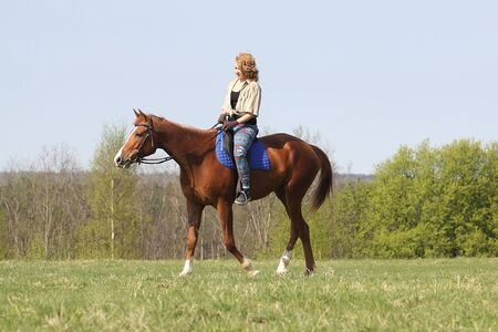 Girl riding Russian Don horse at summer day  photo