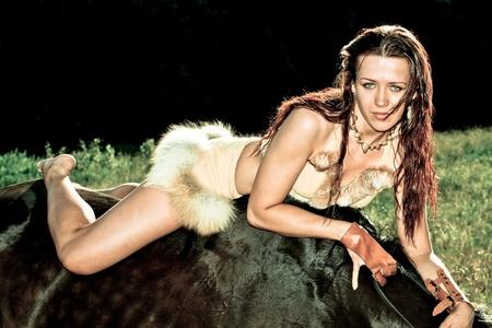 Beautiful young amazon on horseback photo