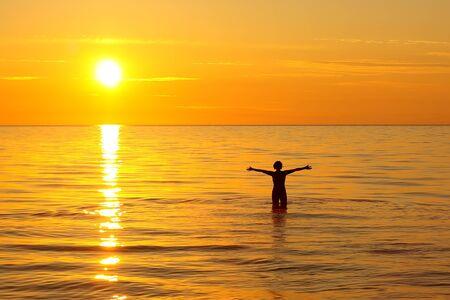 Woman bathing in the Ladoga lake at dawn time Archivio Fotografico