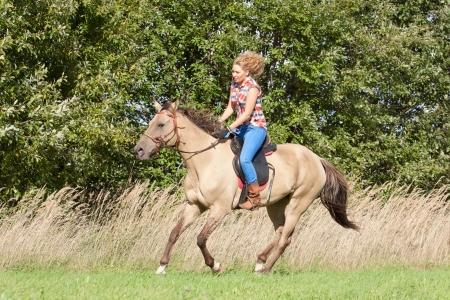 horse pull: Girl riding a beautiful Akhal-Teke mare