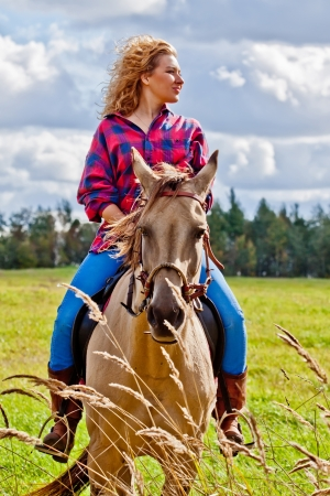 horse pull: Young woman riding a beautiful Akhal-Teke mare