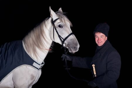 Man standing with his horse of Tersk breed  Stock Photo