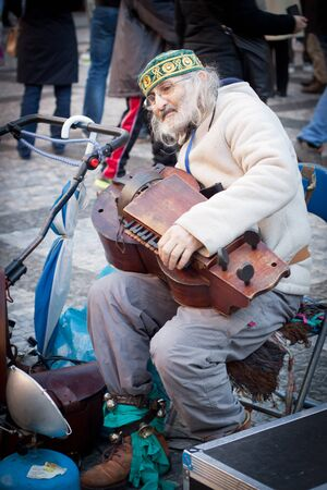instrumentalist: PRAGUE, CZECH REPUBLIC - JAN 02: Musician on Staromestske namesti (Old Town Square) on Jan 02, 2013 in Prague.