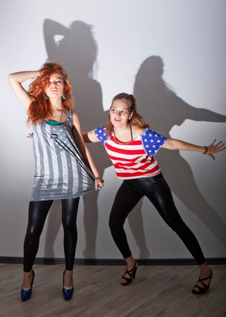 Two beautiful girls wearing T-shirts with American flag photo