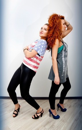 Two beautiful girls wearing T-shirts with American flag Stock Photo - 17414555