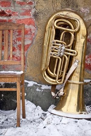 Old chair and tuba on a grunge background Reklamní fotografie