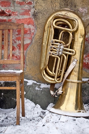 Old chair and tuba on a grunge background Archivio Fotografico