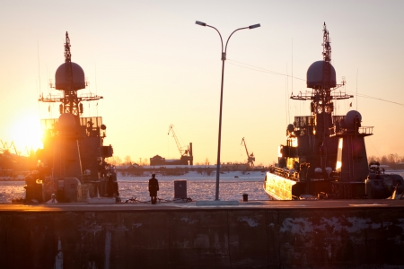ST. PETERSBURG, RUSSIA - MAR 08: Warships on the pier in Kronstadt on March 08, 2013 in St. Petersburg, Russia