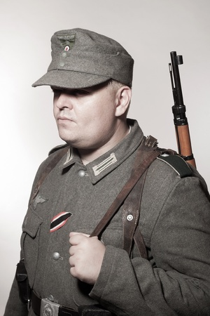 army face: Man in clothes of German soldier Third Reich Stock Photo