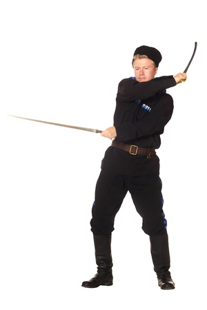 papakha: Young man in Cossack clothes fencing two sabers