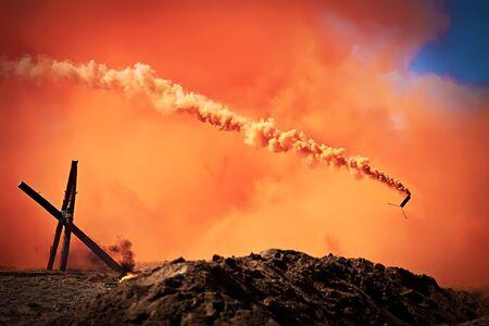 suffocating: Bright orange and red smoke of smoke bombs