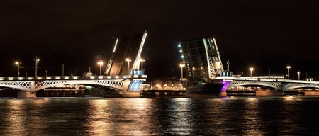 lieutenant: Annunciation bridge (Lieutenant Schmidt Bridge) at night. St. Petersburg, Russia. Stock Photo