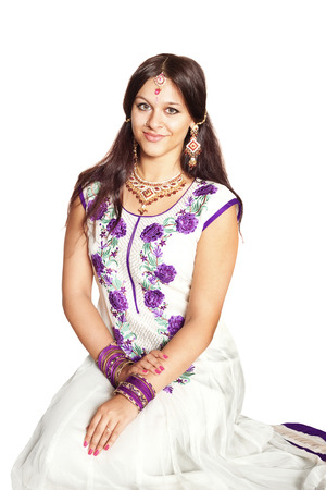 Indian girl in traditional clothes, isolated on white background
