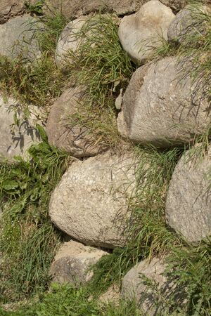 The wall of large boulders Stock Photo