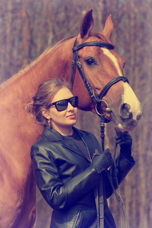 Young woman and Russian Don horse  photo