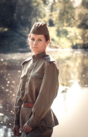Young woman wearing Red Army form of 1943 year. Defocused effect of old photos. photo