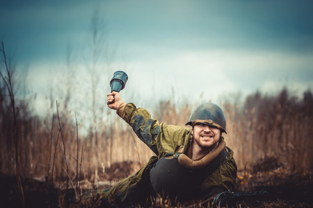 Young man in Red Army form posing with the RPG-43 (Soviet anti-tank hand grenade) Archivio Fotografico