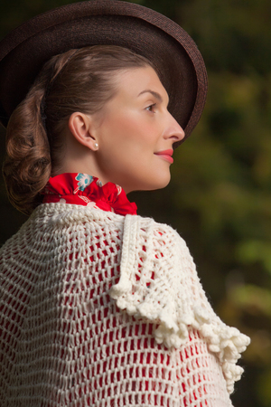 Young beautiful woman posing in vintage clothes photo