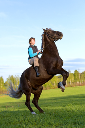 rearing: Young woman and her beautiful horse rearing up