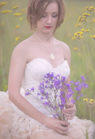 girl holding flower: Beautiful girl holding flower bouquet in her hands Stock Photo