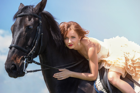 Beautiful girl in vintage dress and her horse