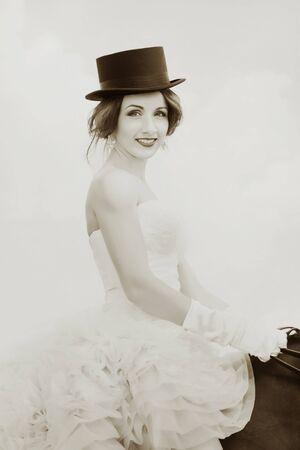 a frill: Pretty girl in vintage dress on horseback. Retro photo effect.