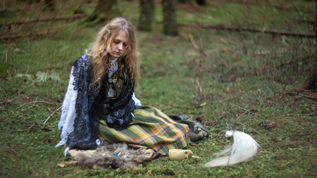 lamia: Young beautiful witch in the woods, soft focus