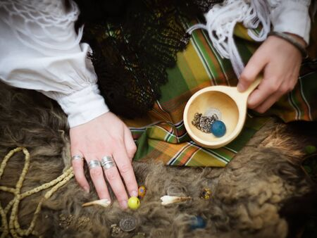 sibyl: A young girl prepares some things for witchcraft Stock Photo