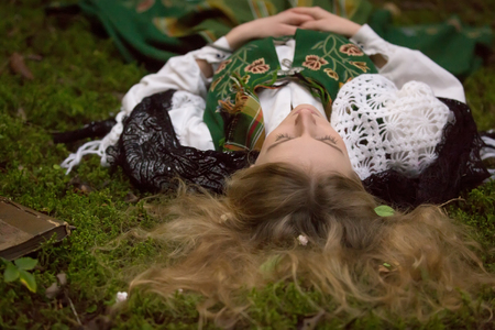 lamia: Young girl lying on the ground in the forest