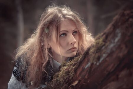 sibyl: Young beautiful witch in the woods Stock Photo