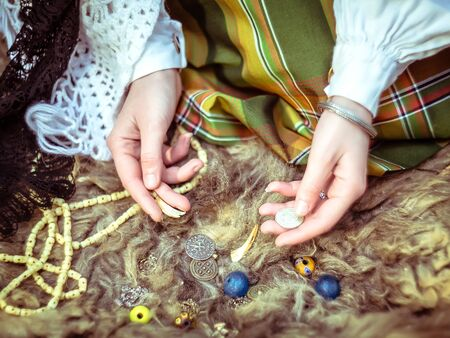 lamia: A young girl prepares some things for witchcraft Stock Photo