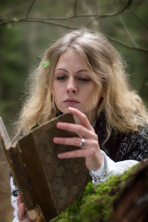 lamia: Young beautiful witch in the woods Stock Photo
