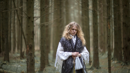 sibyl: Young beautiful witch in the woods, soft focus