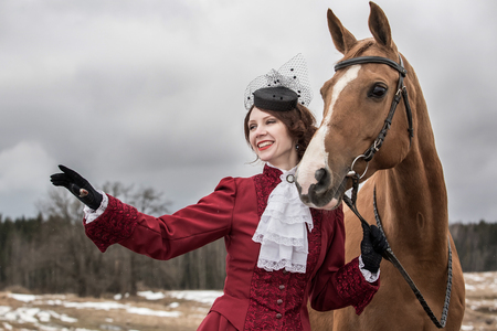 a frill: Young woman in vintage stylized suit with Russian Don horse Stock Photo