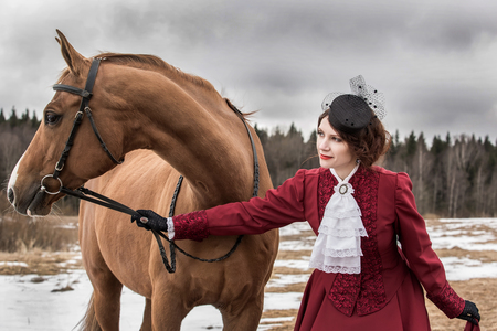 jabot: Young woman in vintage stylized suit with Russian Don horse Stock Photo