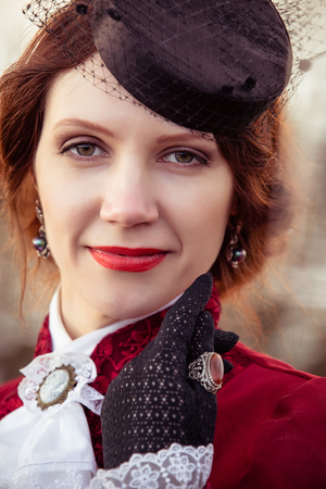 jabot: Portrait of a woman in vintage stylized suit and hat Stock Photo
