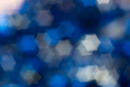 Blurred hexagonal blue bokeh as abstract background