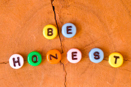 honest: Colored be honest on wooden background Stock Photo