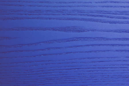 blu: Wooden background with blue streaks in relief