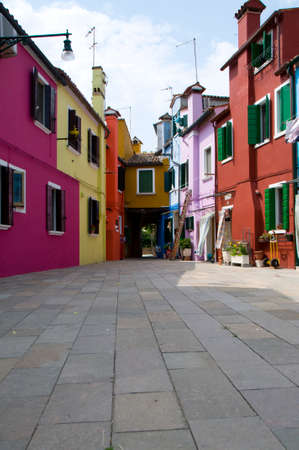 The colors of the walls of Burano island, Venice, Italy photo