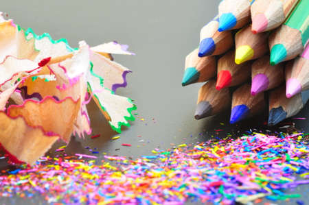 Conceptual photo representing what we are and what we could become, shown through colored pencils with colored shavings.