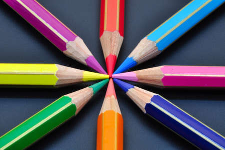 Many colored pencils close up, metaphor of strategy and teamwork