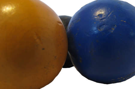 yellow, black and blue crocquet balls photo